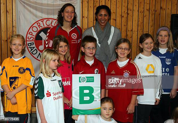 Director of German Football Association Steffi Jones and Almuth Schult pose for a picture after the draw during the Women's German Indoor Cup press...