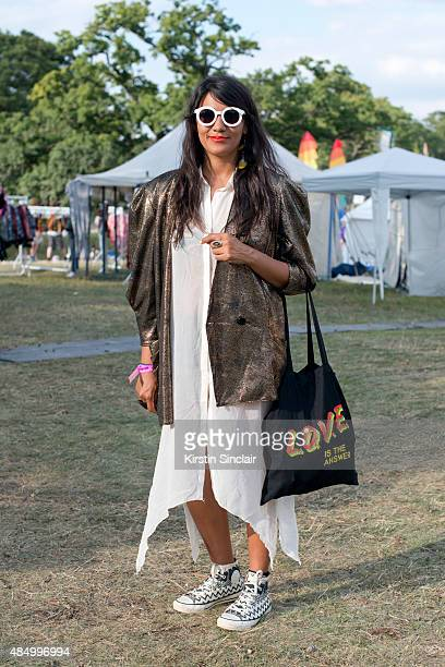 Director of Haus of Artisans Susan Katerine Rozo Arias wears a vintage jacket and dress Missoni for Converse trainers LOVE bag on day 2 of the...