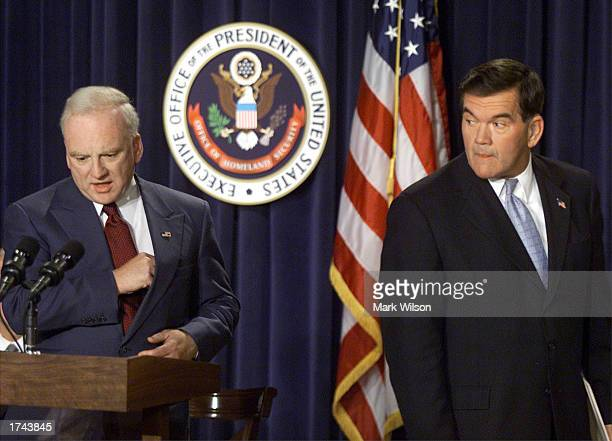 Director of Homeland Security Tom Ridge walks away after introducing Richard Clarke as a new member of US President George W Bush's counterterrorism...