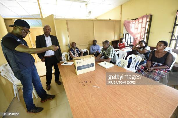 Director of institute Ephraim IgbaniEmovon looks on while World Health Official official Kevin Ousman speaks about prevention and control of Lassa...