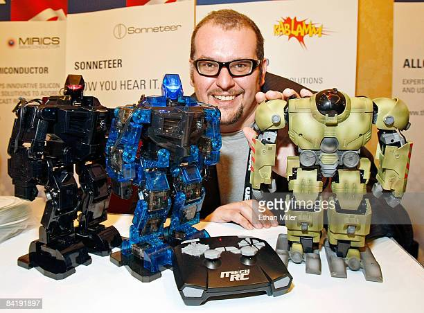 Director of Kablamm Ltd Dr Jim Wyatt shows off MechRC humanoid robots Shadow Stalker EDE and Ground Pounder during a press event at the Venetian for...