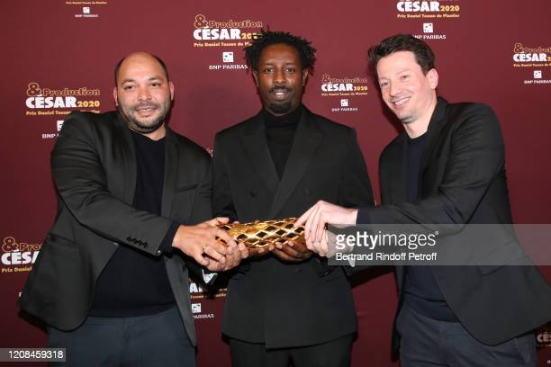 Director of Les Miserables Ladj Ly standing between Winners of the 'Daniel Toscan du Plantier' Producer's Prize 2020 Producers of Les Miserables...