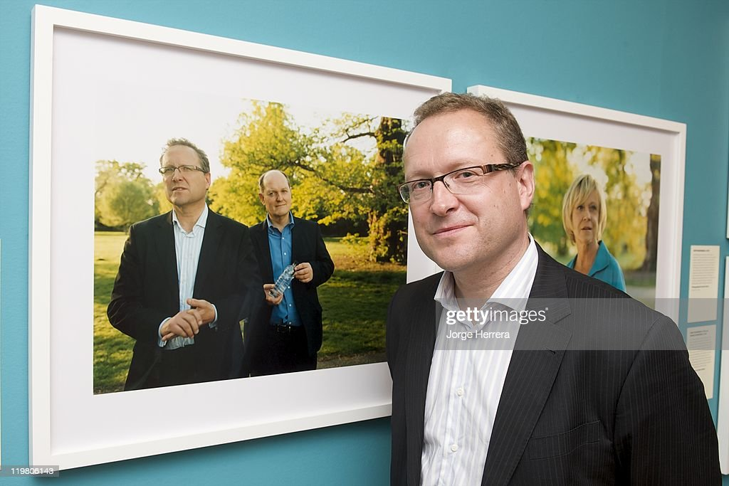 Director of London 2012 for Olympic host nation broadcaster, the BBC Roger Mosey, poses by his portrait during 'Road to 2012: Changing Pace,' the unveiling of new portraits of the people making London 2012 happen, at the National Portrait Gallery on July 25, 2011 in London, England.