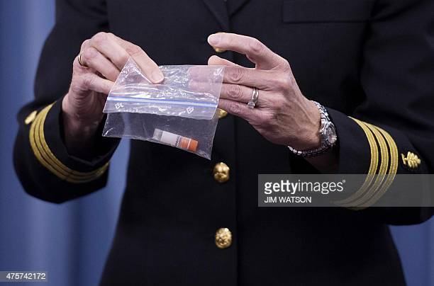 Director of Medical Programs for DoD Chemical and Biological Defense Commander Franca Jones demonstrates how Anthrax is shipped to labs during a...