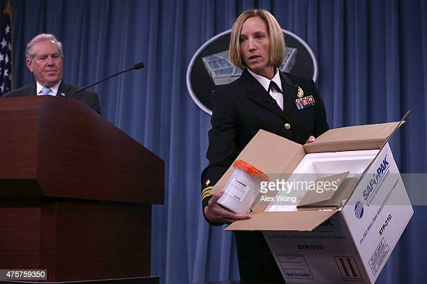 Director of Medical Programs for DoD Chemical and Biological Defense Cdr Franca Jones demonstrates the protocol for shipping anthrax sample as Under...