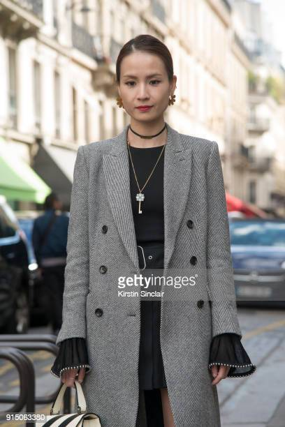 Director of Merchandising Tracey Cheng wears a Uniqlo coat Alexander Wang top Acne skirt day 5 of Paris Womens Fashion Week Spring/Summer 2018 on...