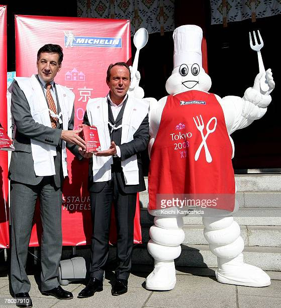 Director of Michelin Guides JeanLuc Naret Michelin Japan President Bernard Delmas and the Michelin mascot pose with the Michelin Guide Tokyo 2008...