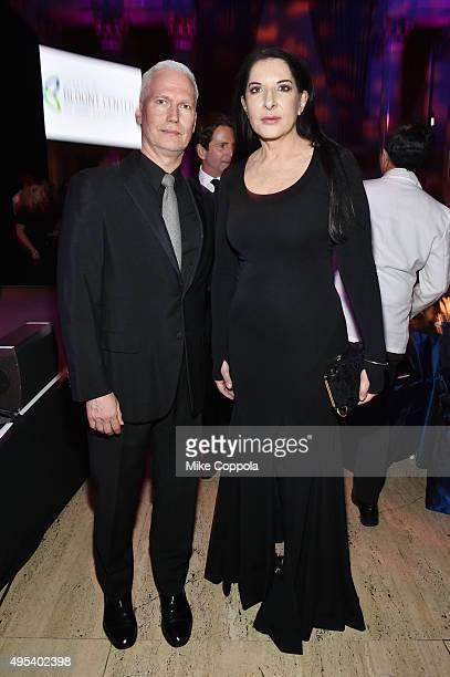 Director of MoMA PS1 and and Chief Curator at Large at The Museum of Modern Art Klaus Biesenbach and Performance artist Marina Abramovic attend Elton...