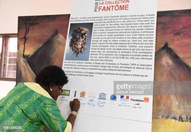 Director of Museum of Civilisations of Ivory Coast Silvie Memel Kassi signs the Manifesto for ghost collection aimed at raising awareness on the...