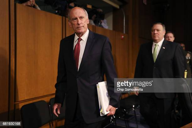 Director of National Intelligence Dan Coats and Central Intelligence Agency Director Mike Pompeo arrive before testifying to the Senate Intelligence...