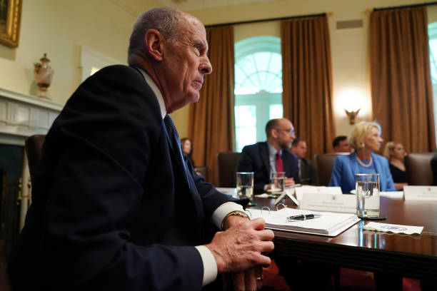 Director of National Intelligence Dan Coats attends a cabinet meeting at the White House July 16 2019 in Washington DC President Donald Trump and...