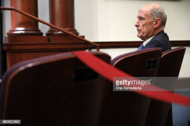 S Director of National Intelligence Dan Coats listens to National Security Agency Director Michael Rogers argue for the renewal of Section 702 of the...