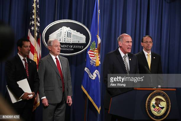 S Director of National Intelligence Dan Coats speaks as Attorney General Jeff Sessions Deputy Attorney General Rod Rosenstein and National...