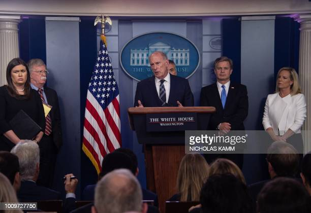 Director of National Intelligence Dan Coats speaks at the press briefing at the White House in Washington DC on August 2 beside Press Secretary Sarah...