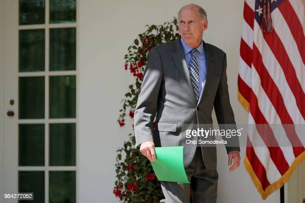 S Director of National Intelligence Dan Coats walks along the Rose Garden Colonnade before an event to mark the National Day of Prayer at the White...