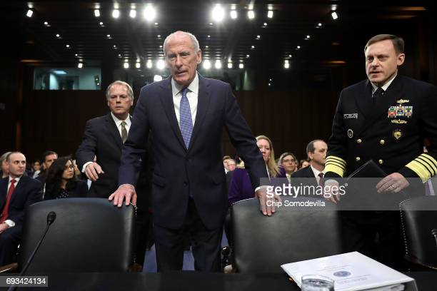Director of National Intelligence Daniel Coats and National Security Agency Director Adm Michael Rogers arrive to testify before the Senate...