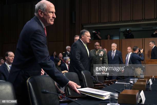 Director of National Intelligence Daniel Coats and the other heads of the United States intelligence agencies arrive for a hearing before the Senate...