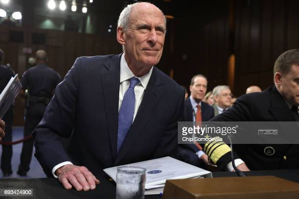 Director of National Intelligence Daniel Coats prepares to testify before the Senate Intelligence Committee in the Hart Senate Office Building on...