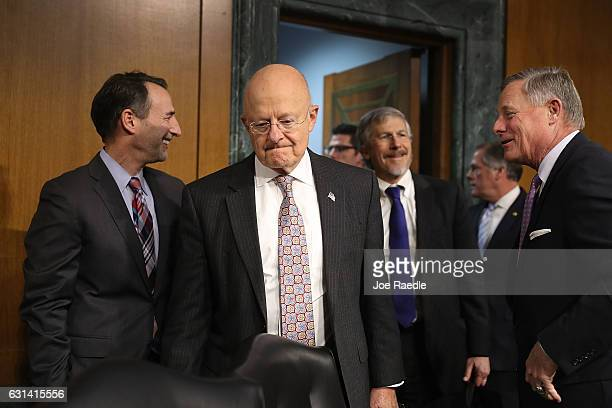 Director of National Intelligence James Clapper arrives to testify before the Senate Intelligence Committee in the Dirksen Senate Office Building on...