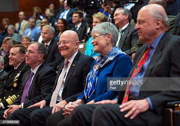 Director of National Intelligence James Clapper sits with his wife Sue during a ceremony marking the 10th anniversary of the formation for the Office...