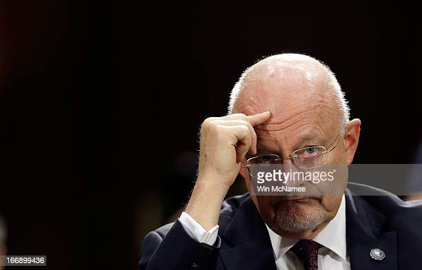 Director of National Intelligence James Clapper testifies before the Senate Armed Services Committee April 18 2013 in Washington DC The committee...