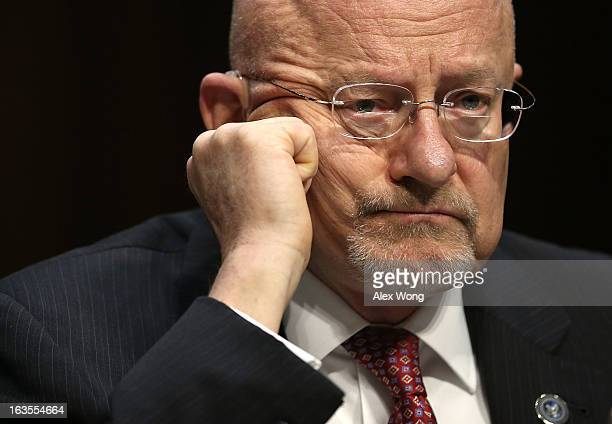 Director of National Intelligence James Clapper testifies during a hearing before the Senate Intelligence Committee March 12 2013 on Capitol Hill in...