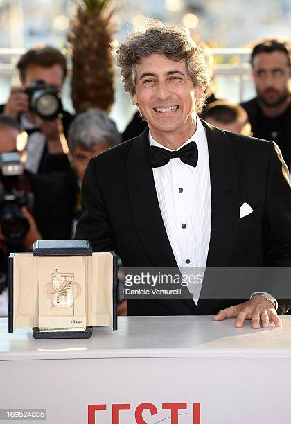 Director of 'Nebraska' Alexander Payne poses with the 'Prix D'Interpretation Masculine' which he received on behalf of Bruce Dern at the photocall...