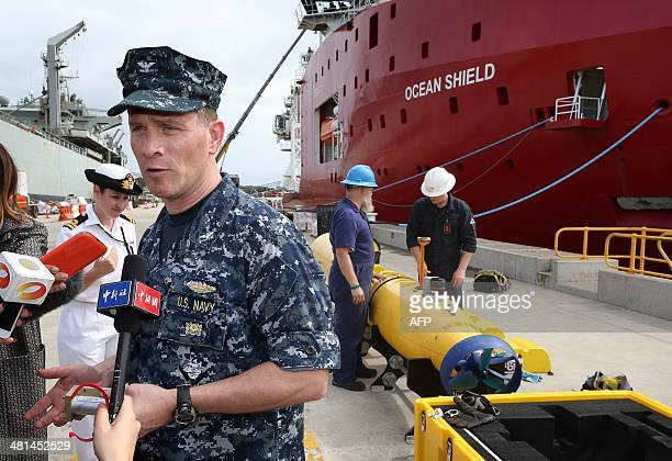 Director of Ocean Engineering of the US Navy captain Mark Matthews speaks to the media as workers assemble a Blue Fin 21 automatic Underwater Vehicle...