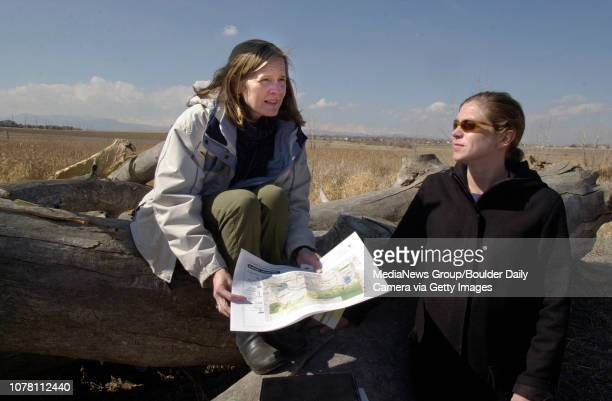 Director of Open Space and Trails Kristan Pritz, left, and Ronda Jo Ackerman-Alford look at maps of the Broomfield County Commons beside a dead...