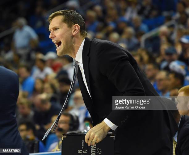 Director of operations Kory Barnett of the UCLA Bruins yells from the bench during the game against the Detroit Mercy Titans at Pauley Pavilion on...