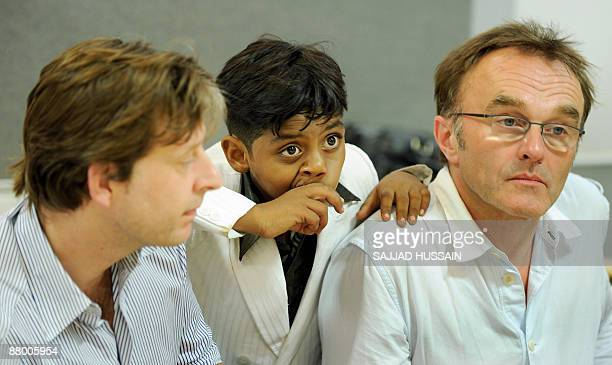 Director of Oscar winning movie 'Slumdog Millionaire' Danny Boyle producer Christian Colson and child star Mohammad Azharuddin listen to a question...