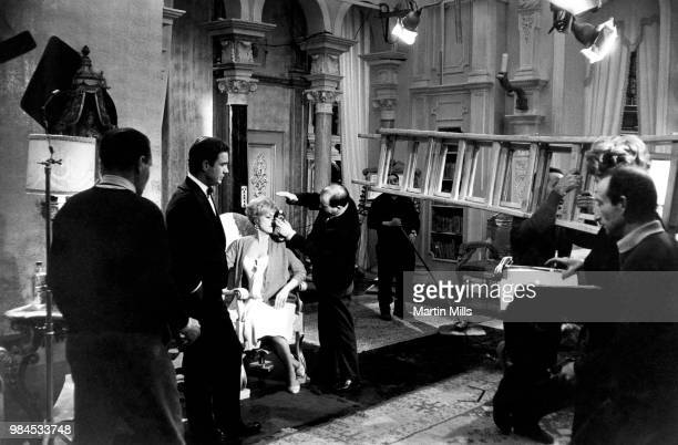 Director of photography Gianni Di Venanzo checks the lighting for the scene with American comedienne actress singer and businesswoman Edie Adams and...