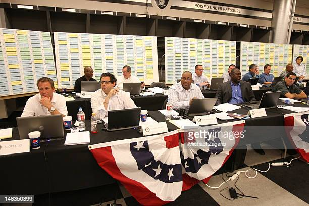 Director of Player Personnel Billy Owens of the Oakland Athletics sits with some of the scouts in the war room during the first day of the MLB Draft...