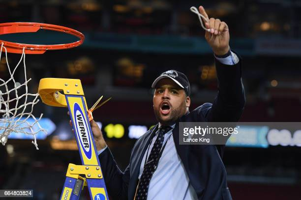 Director of player personnel Sean May of the North Carolina Tar Heels cuts the net following their 7165 victory against the Gonzaga Bulldogs during...