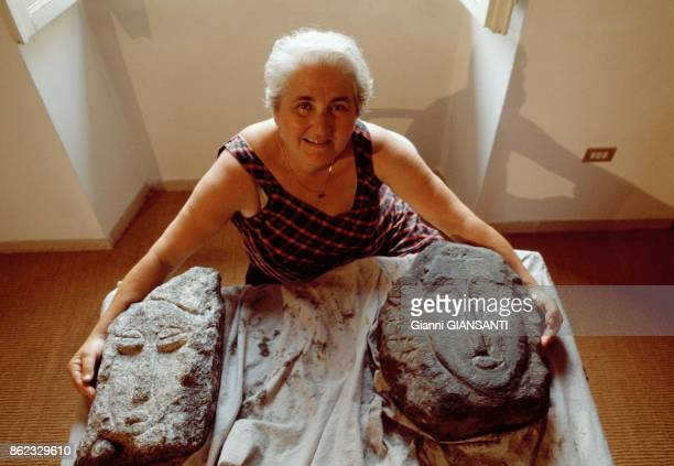 Director of recovery operations Vera Durbe poses with the two statues that could have been sculpted by Modigliani and that were found in a Livorno...