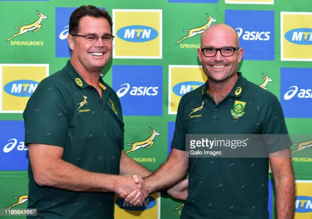 Director of Rugby Rassie Erasmus shakes hands with head coach Jacques Nienaber during the Springbok press conference at Southern Sun Pretoria on...
