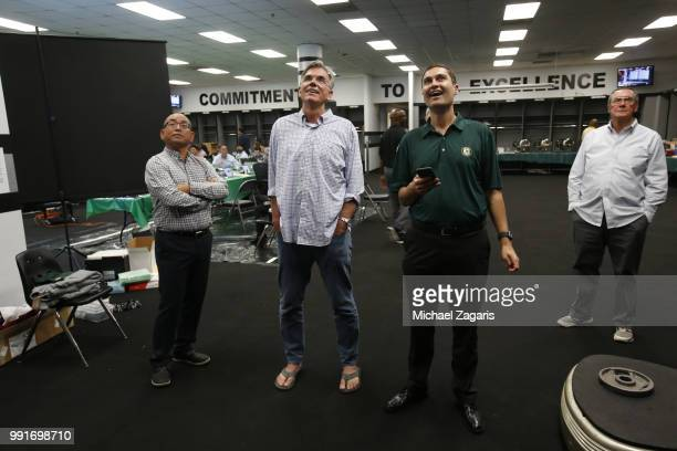 Director of Scouting Eric Kubota Executive Vice President of Baseball Operations Billy Beane and President David Kaval of the Oakland Athletics watch...