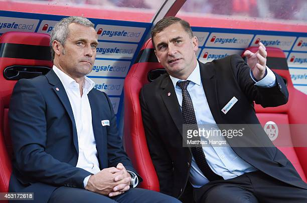 Director of sport Markus Schupp of Kaiserslautern talks to chief executive officer Stefan Kuntz of Kaiserslautern before the Second Bundesliga match...