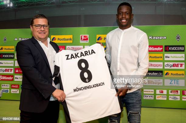 June 09: Director of Sport Max Eberl and Denis Zakaria pose with his new jersey after signing a contract with Borussia Moenchengladbach at...