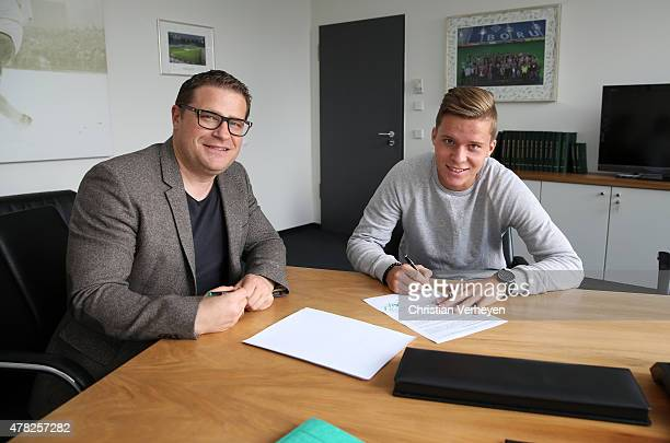 Director of Sport Max Eberl and Nico Elvedi of Borussia Moenchengladbach during signing a new contract for Borussia Moenchengladbach on June 24 2015...