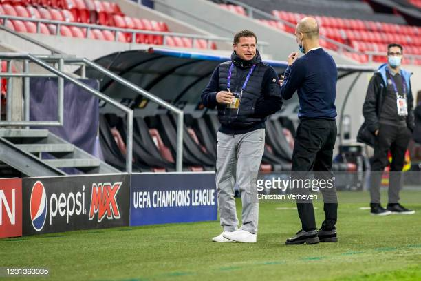 Director of Sport Max Eberl of Borussia Moenchengladbach and the coach of Manchester City Pep Guardiola are seen before the UEFA Champions League...