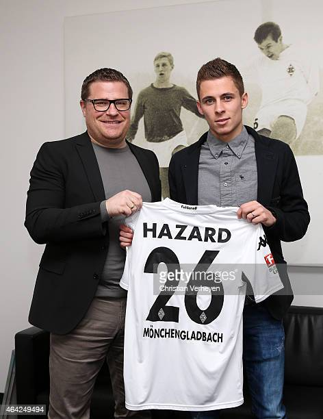Director of Sport Max Eberl of Borussia Moenchengladbach and Thorgan Hazard of Borussia Moenchengladbach pose for a photo as he signs a new contract...