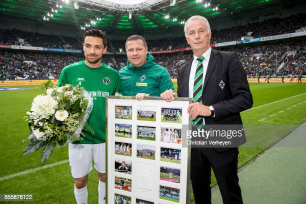Director of Sport Max Eberl of Borussia Moenchengladbach and Vice President Rainer Bonhof of Borussia Moenchengladbach say goodbye to Julian Korb of...