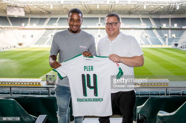 Director of Sport Max Eberl pose with Alassane Plea after he signs a new contract for Borussia Moenchengladbach at BorussiaPark on July 12 2018 in...
