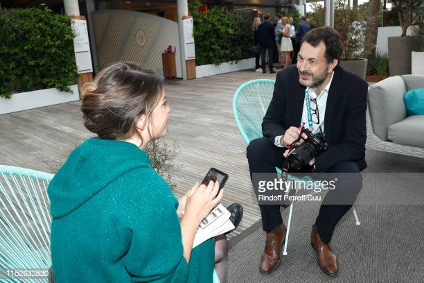 Director of sports at France Television LaurentEric Le Lay and a guest attend the 2019 French Tennis Open Day Five at Roland Garros on May 30 2019 in...