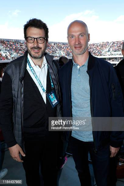 Director of sports at France Television LaurentEric Le Lay and Handball Player Thierry Omeyer poses at France Televisions french chanel studio during...