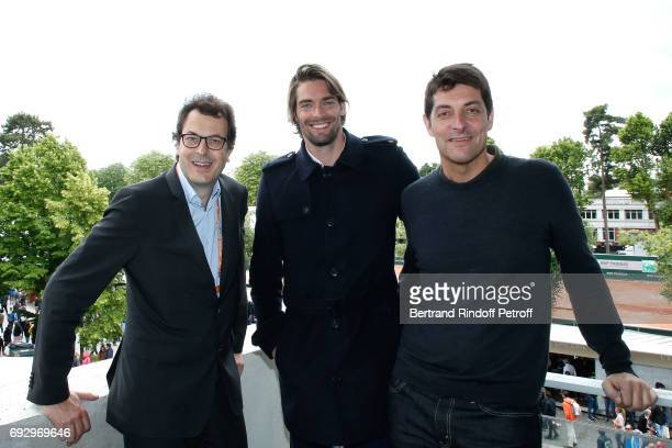 Director of Sports at 'France Television' LaurentEric Le Lay Swimmer Camille Lacourt and journalist Alexandre Boyou attend the 2017 French Tennis...
