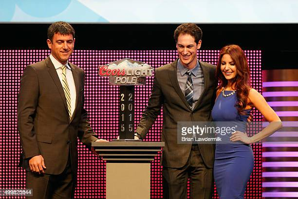 Director of Sports Entertainment Marketing at Miller Coors Adam Dettman presents NASCAR Sprint Cup Series driver Joey Logano with the 2015 Coors...