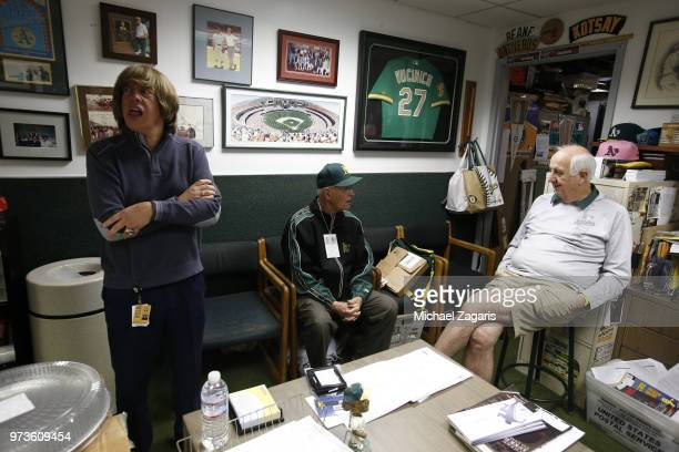 Director of Team Travel Mickey Morabito Monte Moore and Equipment Manager Steve Vucinich of the Oakland Athletics talk in the clubhouse prior to the...
