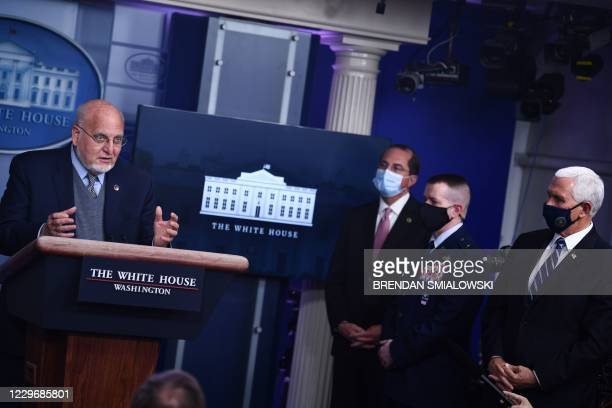 Director of the Centers for Disease Control Robert Redfield speaks as US Secretary of Health and Human Services Alex Azar and Vice President Mike...